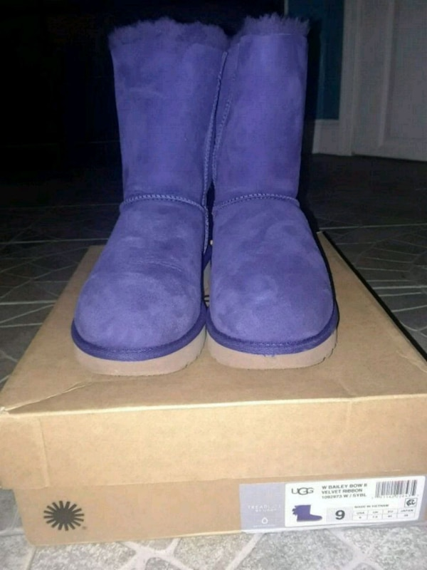 dd970b99583 pair of purple UGG boots with box
