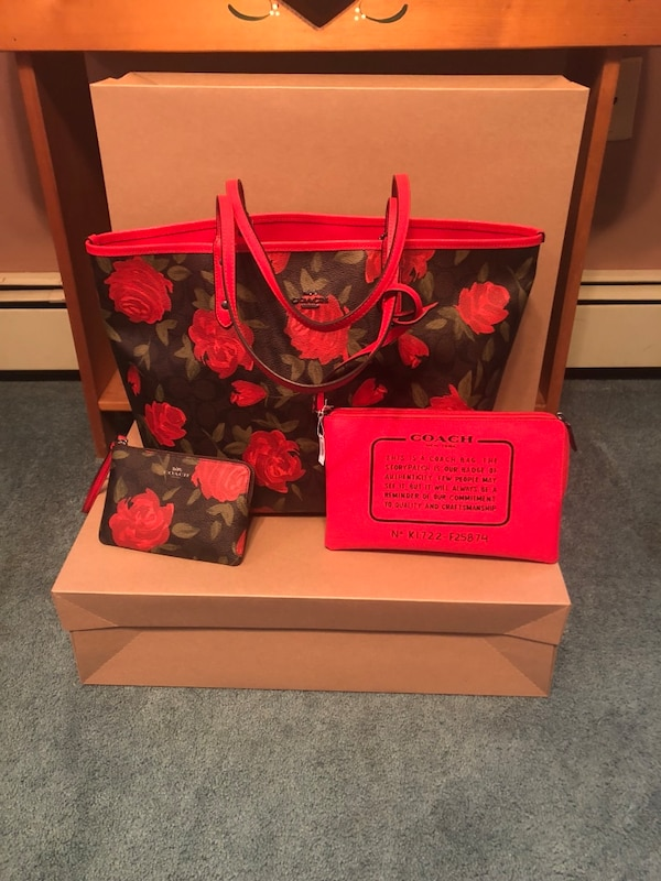 women's black and red floral Coach handbag and wristlet