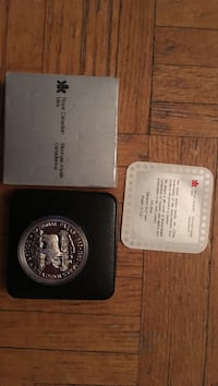 silver-colored Royal Canadian Mint commemorative coin Toronto, M4B 2G1