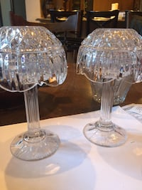 Two crystal clear glass table decors.