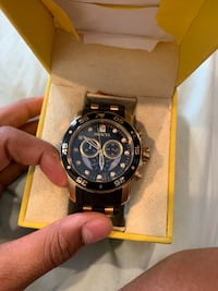 Gold Invicta watch