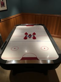 white and black air hockey table 538 km