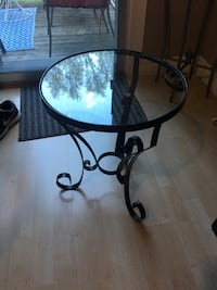 "Glass and wrought iron small table 17 1/2 "" h x 14 1/2"" in diameter"