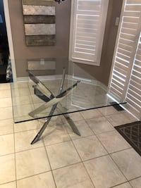 Glass table with solid silver base