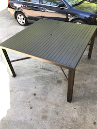 brown and gray wooden patio table