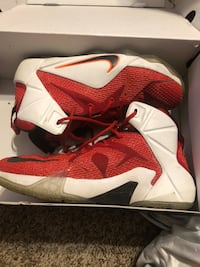 pair of red Nike basketball shoes Cleburne, 76033