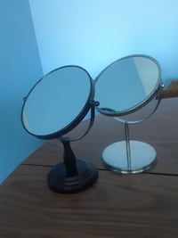 two black and gray vanity mirror