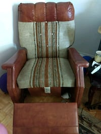 brown wooden framed gray padded armchair Toronto, M1W 3R3