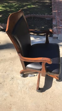 brown wooden framed black padded armchair 2276 mi