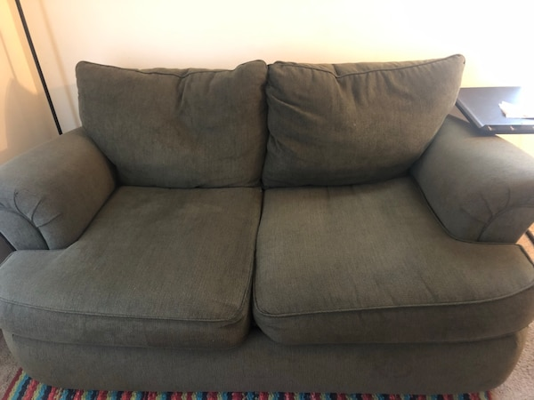 Green 2 seater fabric couch
