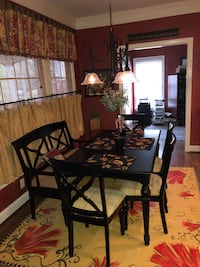 Rectangular black wooden table with four chairs and bench dining set