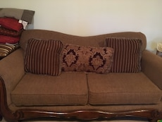 brown 2-seat sofa armchair with three pillows