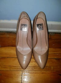 pair of brown leather pointed-toe heeled shoes