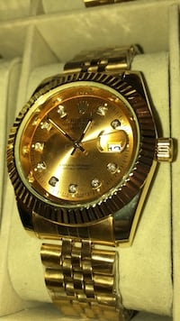 round gold-colored Rolex analog watch with link bracelet Brampton, L6T