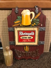 Vintage beer sign and 1800s stone beer bottle