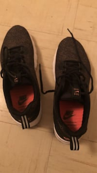 Pair of black-and-red nike running shoes Tulsa, 74110