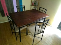 rectangular brown wooden table with four chairs di Bryan, 77801