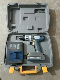 grey cordless power drill in case West Kelowna, V4T 2P6