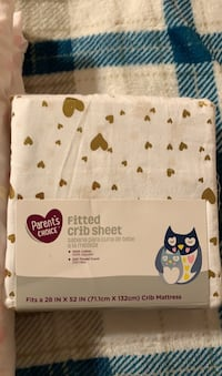 Two fitted crib sheets