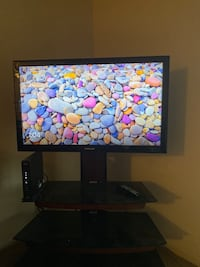 Tv stand with glass shelves and Tv mounting hardware + Samsung Tv Nashville, 37209