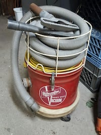 milwauuker red and grey vacuum cleaner