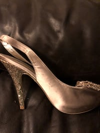 pair of gray leather peep-toe heeled shoes null