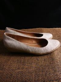 pair of white laser-cut leather flats Olympia, 98502