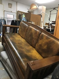 Brown real leather/wooden sofa  owner bought 10years ago paid $5,000 Union City, 07087