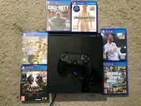 black Sony PS4 console with controller and games Utah