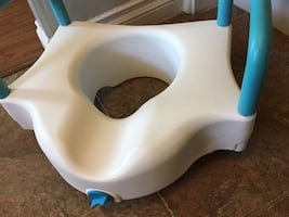 Elevated toilet seat with blue removable handles - $55