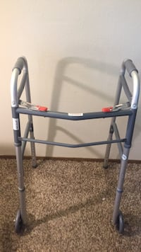 Walker *brand new* never used. Folds for storage