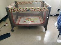 baby's multicolored circle print travel cot 28 mi