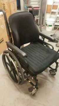 Black and gray wheel chair