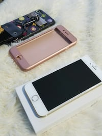 gold iPhone 6 with two cases