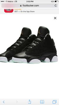 pair of black Air Jordan 13's null