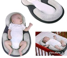 baby positioner.....great for preventing flat head syndrome.