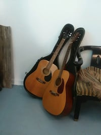 Two guitars and case 233 mi