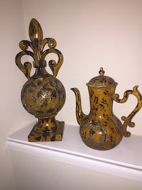 Two brown and black ceramic figurines