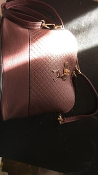 Quilted  maroon leather handbag