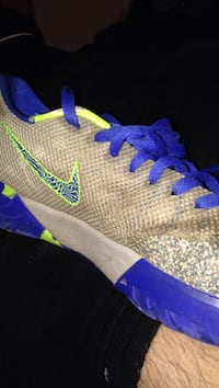 blue, green, and brown Nike low top Liberty, 64068