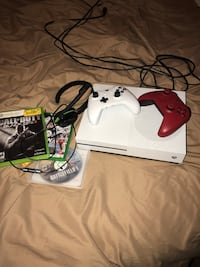 white Xbox One console with controller and game case