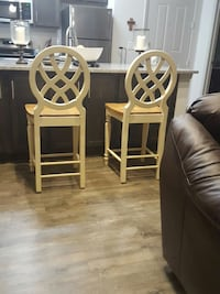 a pair of cream color bar stools