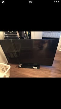 black flat screen TV with remote Jacksonville, 32256