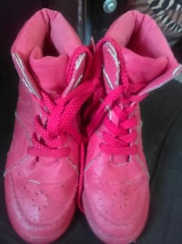 pair of pink high-top shoes