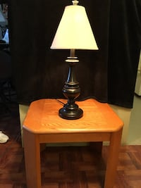 Wood end table with brown lamp beige lamp shade