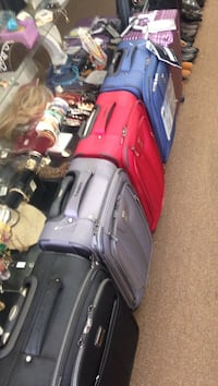 four black, gray, red, and blue soft-case luggages