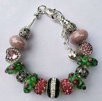 Pink and green charm bracelet. 2 for $25 Baltimore, 21224