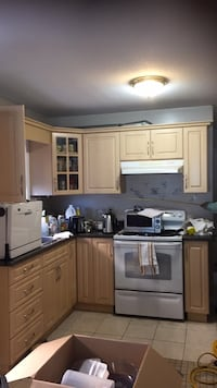 white and brown kitchen cabinet Burnaby, V5J 2C7