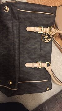 black and white monogrammed Michael Kors leather tote bag