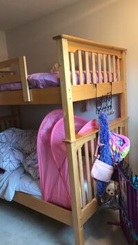 Brown wooden loft bed 2 mattress included  Burnaby, V3N 1N5